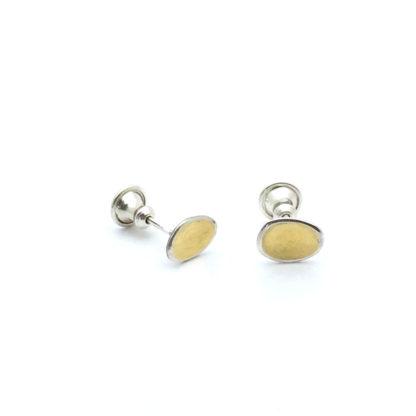 Boucle d'oreille puce en argent et or. Fabrication artisanale.